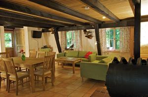 Ferienhaus Dachsbau Kellenhusen, Blick ins Wohnzimmer, Schleswig-Holsteinische Landesforsten